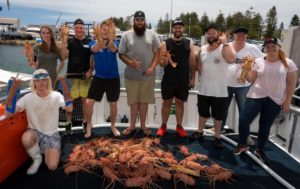 A group with freshly caught crayfish.